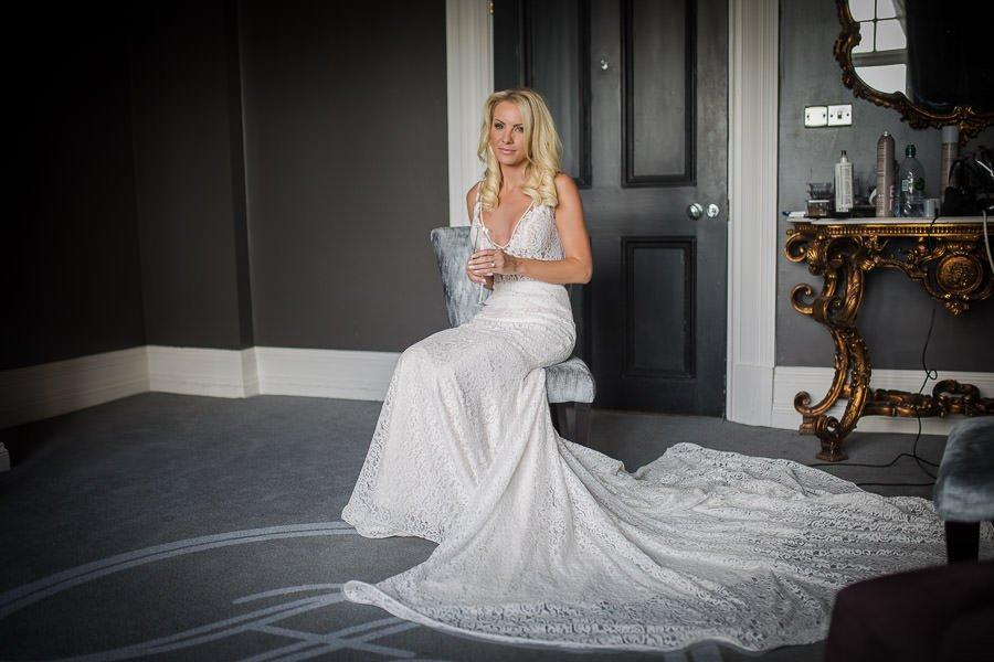 Bride dressed in white wedding dress at