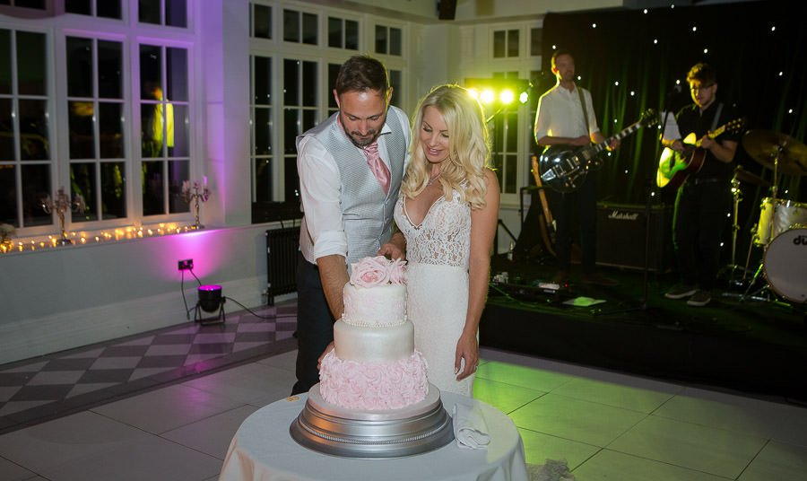 Bride and Groom about to cut the cake at Swynford Manor Wedding