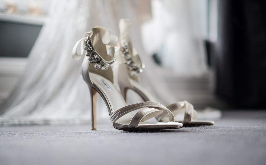 Close up of shoes with dress in back ground at Swynford Manor Wedding