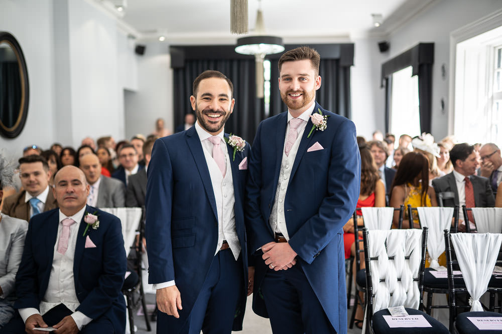 Groom and his best man standing at ceremony room at swynford wedding