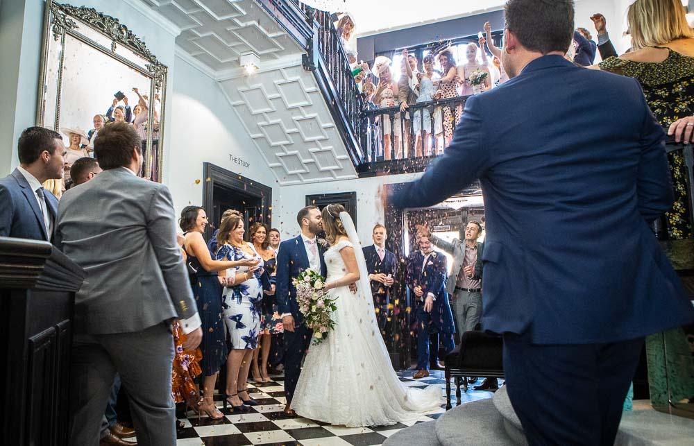 Interior confetti shower at a wedding