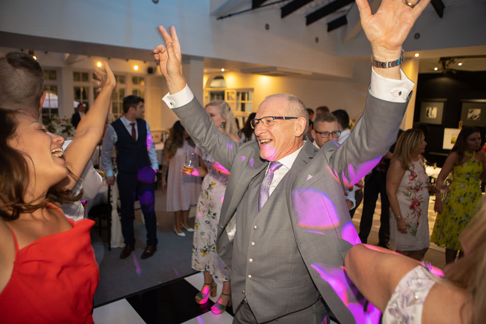 Party guest dancing at Swynford Wedding - photographed by Cambridge wedding photographer