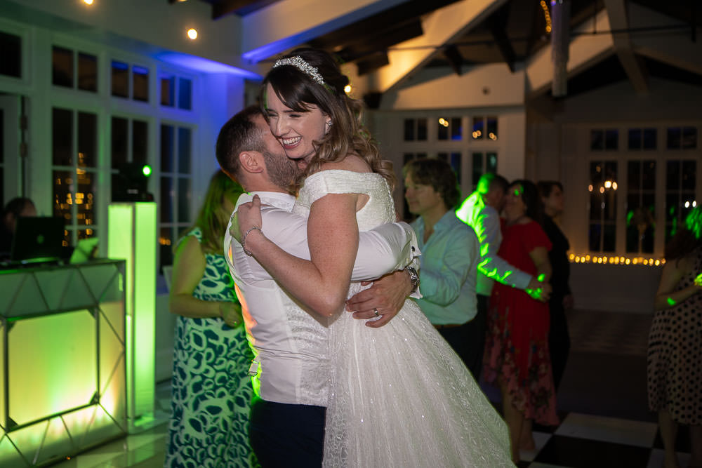 Bride and groom dancing and having fun, photographed by Cambridge Wedding photographer