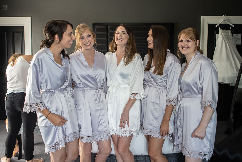 Bridal team in dressing gowns laughing together