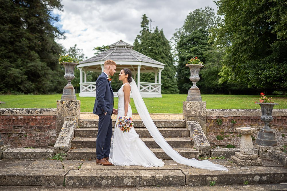 wedding couple posing in grounds of Holmewood Hall at their intimate wedding