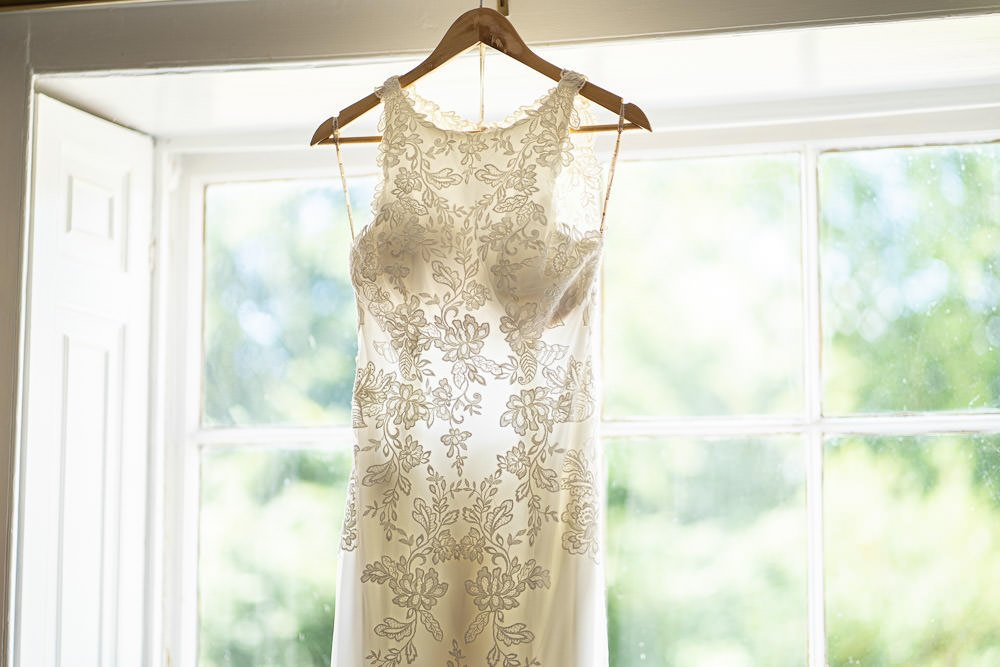 Dress hanging up at intimate wedding at Holmewood Hall