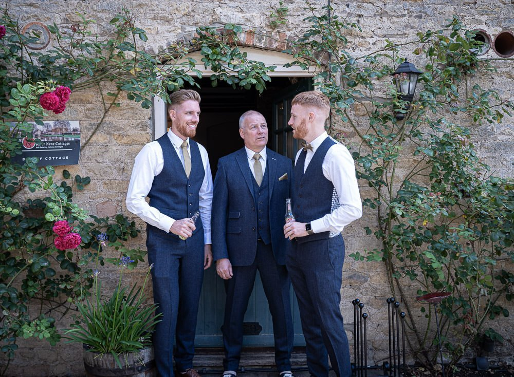 Groom, father and best man.