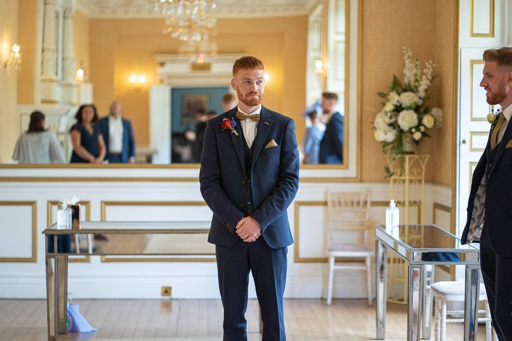 groom looking nervous at intimate wedding at Holmewood Hall