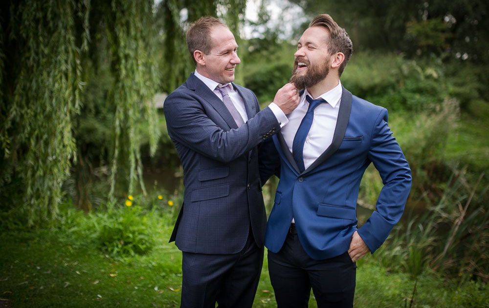 Groom and Best man having fun, demonstrating natural weddin gphotographs, by Cambridge wedding photographer
