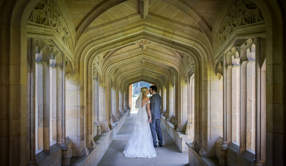 Bride and from standing in the cloisters during their Granary Barns Wedding